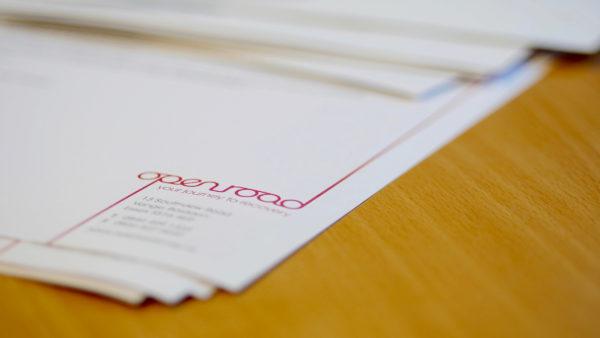 Self referral paperwork on desk