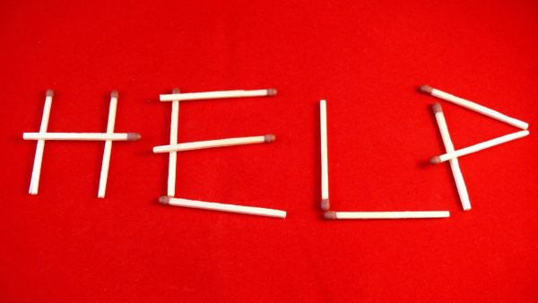 The word Help in matchsticks